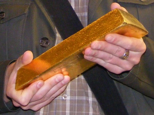Gold bullion. This gold bar weighs 12.5 kilograms ( 27.5 pounds) and is worth about US $600,000 (June 2019.)