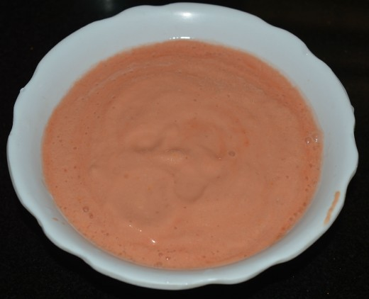 Step two: Grind soaked cashew nuts, almonds, ginger, garlic, and chopped tomato. Get a smooth and creamy paste.