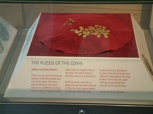 Replica of gold coins and ingots from the Sutton Hoo ship-burial. Were they a funeral offering to pay the ghostly oarsmen of the buried ship?