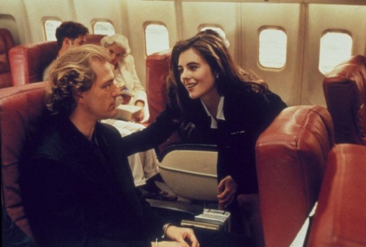 Hurley looks totally different in one of her earliest roles as stewardess Sabrina.