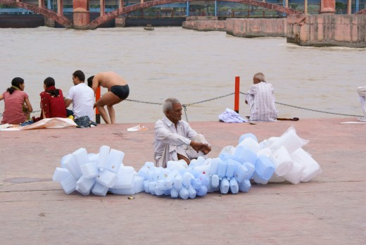Waiting for customers (The man is selling plastic cans to carry holy water from the Ganga which the devotees carry to their homes)