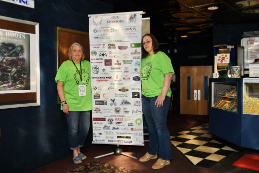 Heather Reichel and Heather Curtis showcasing the many sponsors who helped this event succeed.