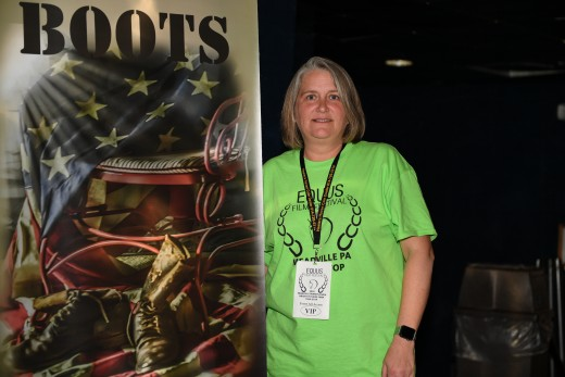 Heather Reichel next to the New Boots poster of the feature film she produced and was shown on Sunday, local day.