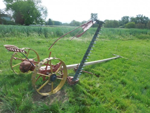 A horse drawn John Deere mower