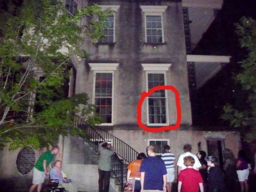 Photo contributed by reader, Steve Miller, that he took of 432 Abercorn Street while on a ghost tour, that appears to show a girl standing in the window. Steve and his wife also experienced an eerie feeling while there, and had camera troubles.