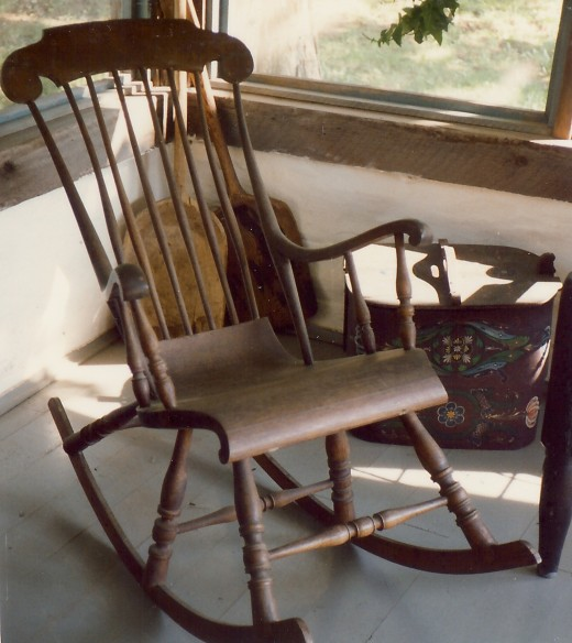 A 3 legged rocker that was carved
