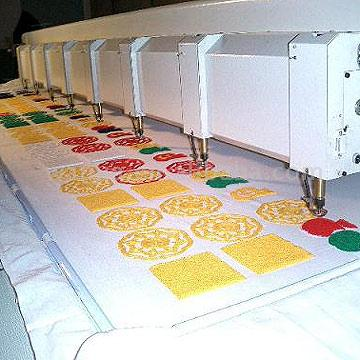 Machine embroidery designs can be executed on large scale industrial machines