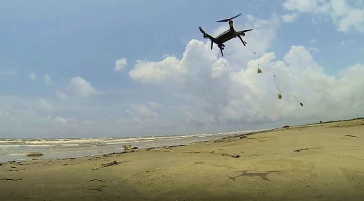 Drone baited with squid and 4oz anchor (spider weight) flying out into the surf.