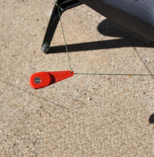 Fishing line snapped into the downrigger and tested for proper tension setting.  Tension settings can be adjusted higher or lower depending on line types and bait weights.