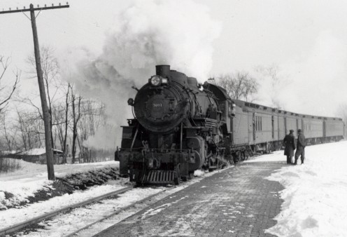 An early railroad locomotive and train.