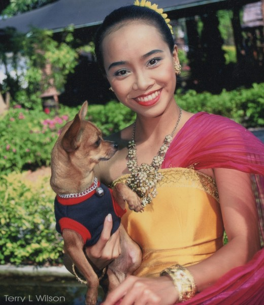 Lovely Thai trainer with her dog Tucha
