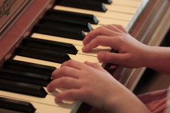 Why Your Child Should Start Playing Piano
