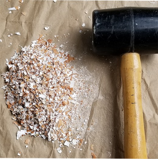 Option #4: Use a rubber mallet to pound the eggshells to crush them. NOTE: Cover the eggshells with another layer of paper before hammering, to avoid eggshell pieces from flying around.