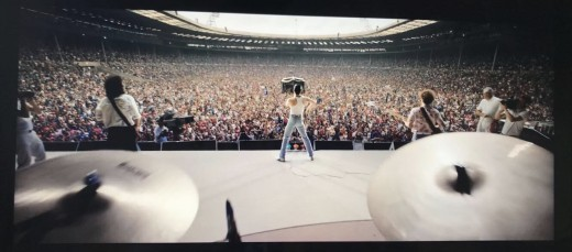 Cast as Queen performing at Live Aid (1985)