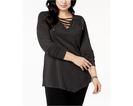 tunic with grommet details and a bold lace-up V-neckline