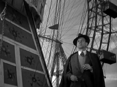 Here's Joseph Cotten at the entrance to the Wheel, waiting for Orson Welles to appear mysteriously. I've been on it two or three times, and the cabins are the same old wooden ones!