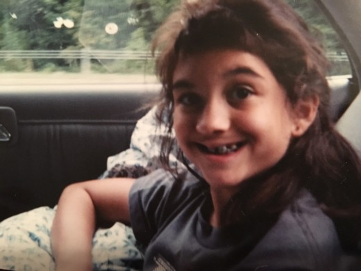 Here I am at age 8. I spent much of my life in braces, having teeth extracted, implanted, and moved around. The inside of my mouth is so scarred that it looks like Frankenstein's monster. But you know what? It's a part of me that makes me me.