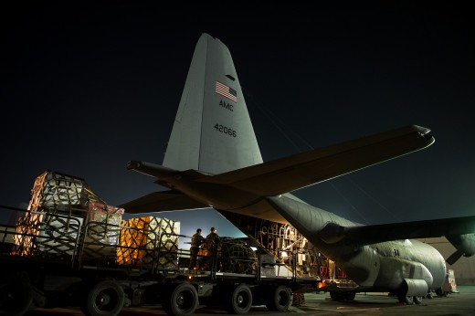 774th Expeditionary Airlift Squadron load pallets on a C-130H; serving Afghanistan.