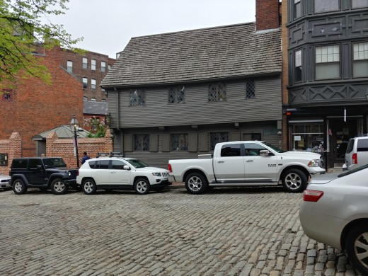 Traffic blocking the view of Paul Revere's house.