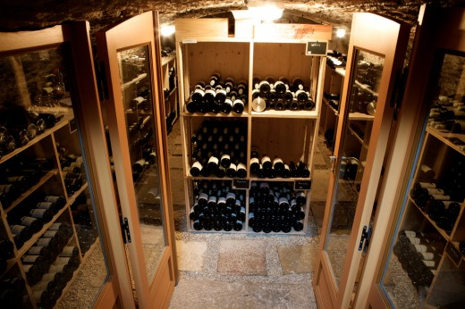 French doors open to a small wine cellar with an old world ambiance.