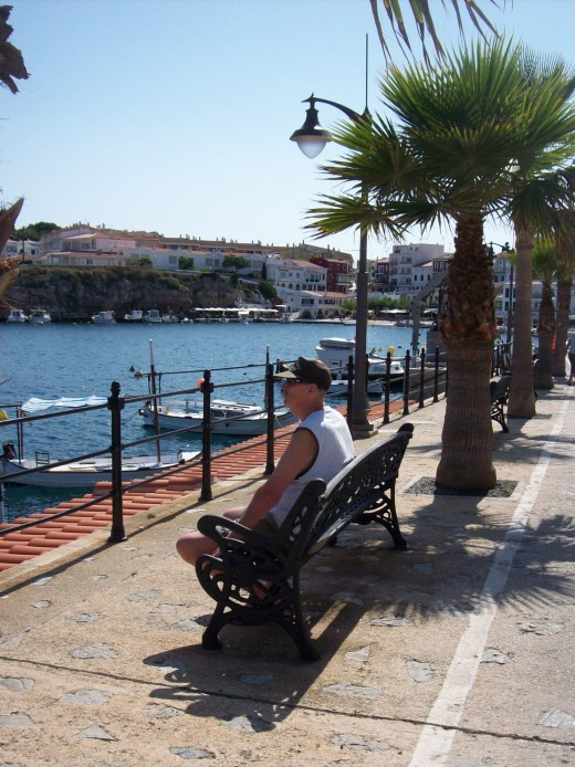 Siting watching the word go by at Cales Fonts