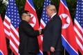 Experts Analyze Donald Trump's Body Language When Meeting Kim Jong Un