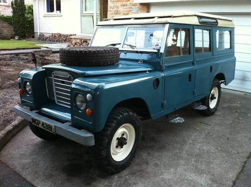 Blue Land Rover 109 inch Safari roof estate - pressurised ventilation - with bonnet mounted spare wheel as mine was purchased in May 1997