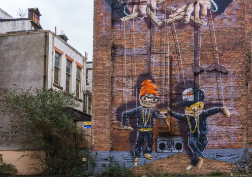 'Hip Hop Marionettes' Street Art on the side of a building in Glasgow