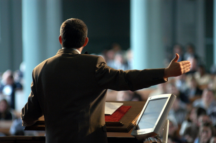 Preacher preaching behind the pulpit.