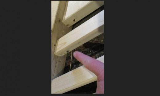 Nailing side rails to hand rail.