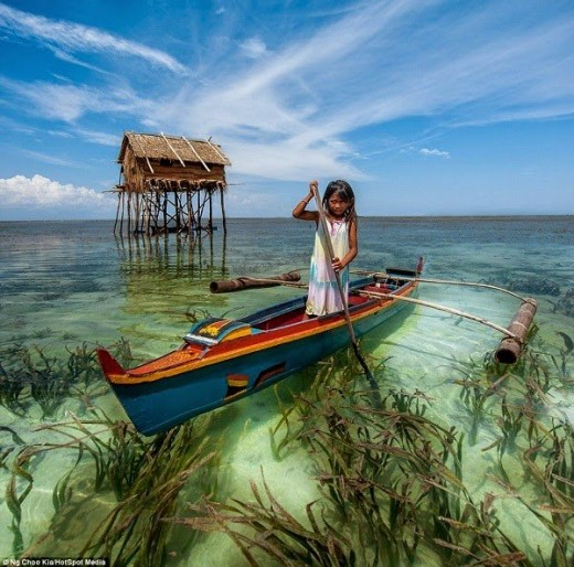 Badjaos in the Philippines live in small huts on stilts. The waters are incredibly clear in Tawi-tawi and Sulu (Mindanao) where the Badjaos live primarily...