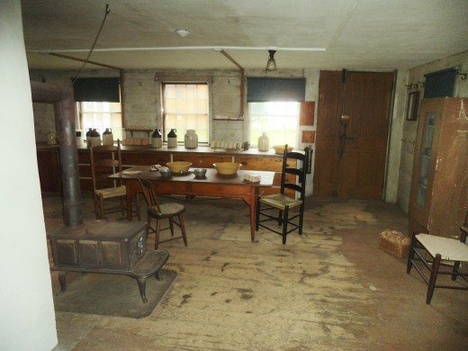 Here's another table and it has drawers in it. Along the window area is a counter for working and large drawers for storage. I'm trying to remember if this was a bakery area, but I don't see any large ovens.