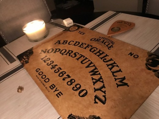 Our setup of the Ouija Board, we did add more candles after this though.