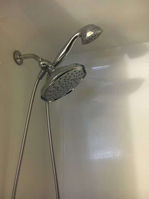 My shower head at home, after loving the showers in Allegro.