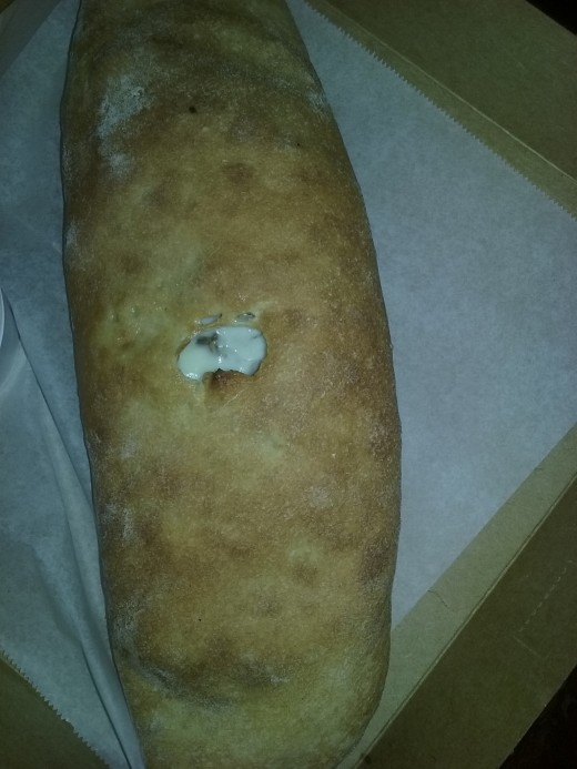 stromboli filled with steak, sausage and cheese