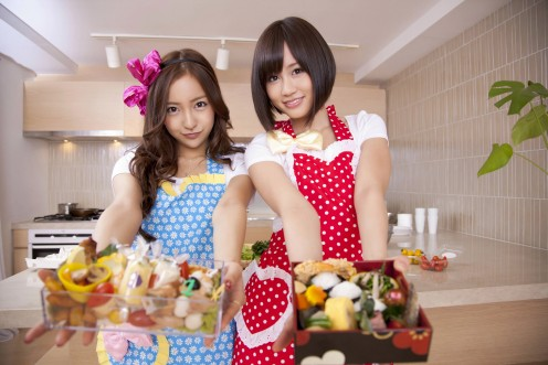 Atsuko Maeda (right) is pictured here with Tomomi Itano (left). Are they giving us food, love or maybe both?
