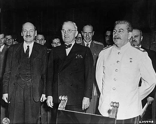 Standing between Soviet Leader, Joseph Stalin and British Prime Minister, Clement Attlee at the Potsdam Conference in 1945.