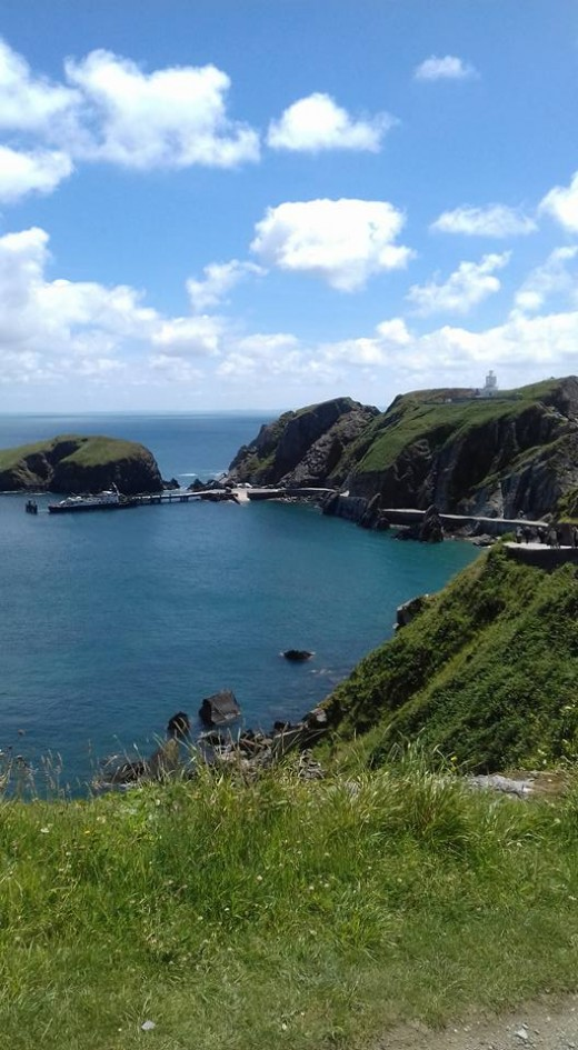 The natural harbor on Lundy Island. If you look closely enough you can see the MS Oldenburg moored up.