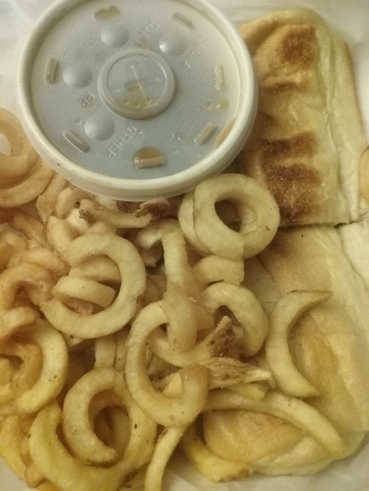 French onion steak sandwich with curly fries