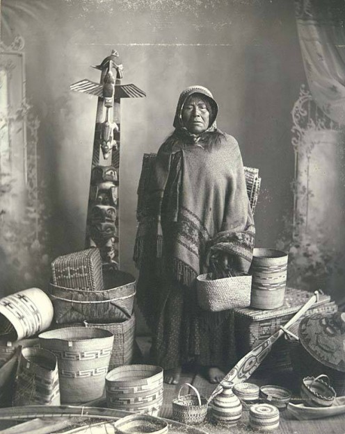 Salishan woman with basket and native art collection in Washington.