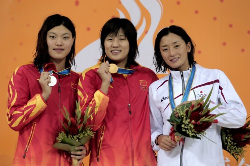 Hanae Ito (right) stands with Qianwei Zhu of China who won the gold medal and Yi tang of China that won the silver medal during the 2010 Asian Games in Guangzhou, China.