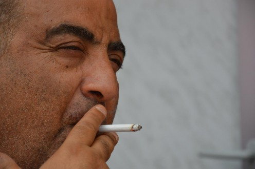 In no way am I condoning, promoting, or agreeing with the nasty habit of smoking. This picture should prove how awful a cigarette can help people to look sad.