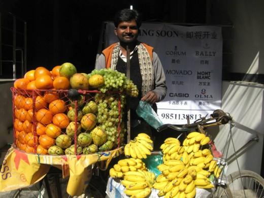 A fruit vendor offers fresh produce on the streets of Kathmandu.