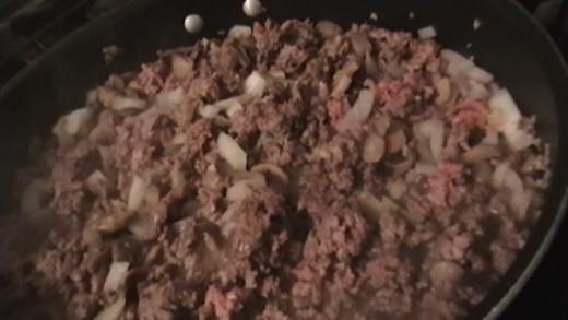 Add chopped onion to ground beef.