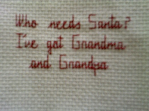 This is an example of a cross stitch tag you can make.  Jus glue a piece of felt on the back and you are good to go.