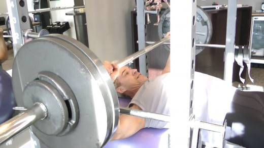 To get the most out of your bench press, focus on perfect form every repetition. Stay present.