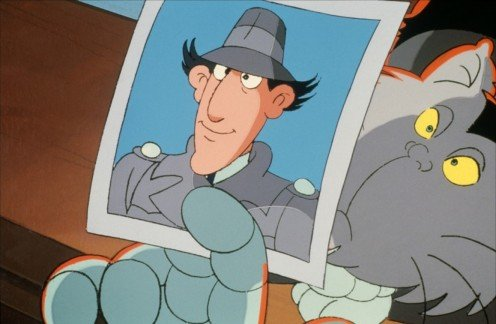 A photo of Dr. Claw holding up a photo of Inspector Gadget the man that he thinks is his biggest foe. His pet MAD Cat is in the photo as well.