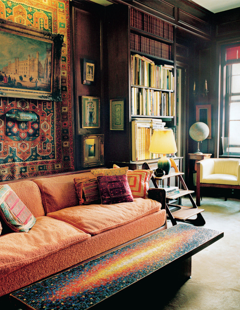 Relics and rich textiles gathered from well-traveled journeys create a room with an exotic aura.