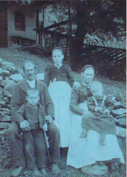 From left to right:  grandma's father, Anton Riedelsperger, grandma, grandma's unidentified stepmother.  In front are grandma's unidentified half-brother and half-sister.
