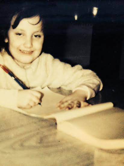 Me, age 9 or 10? Wearing THE sweater, I had it for yrs. till it became too tight. Writing notes to Grandma in the scribble pad.